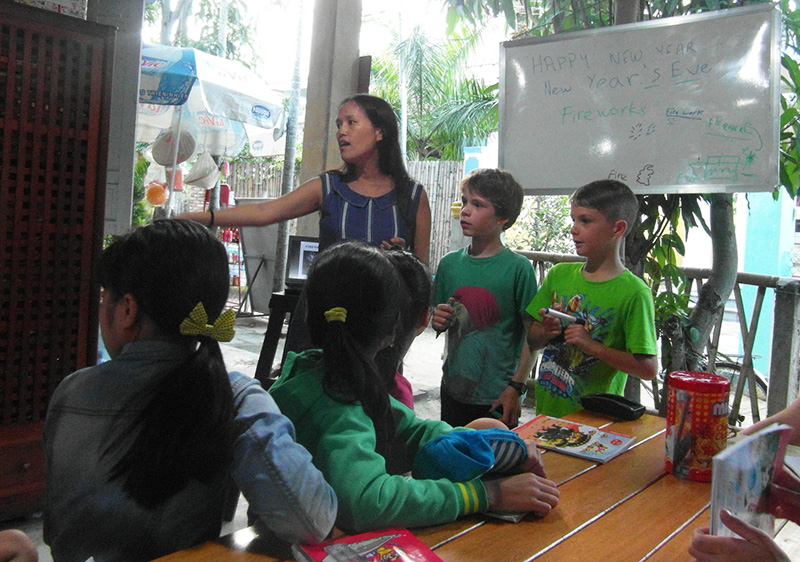 Helping to teach an English lesson in Vietnam